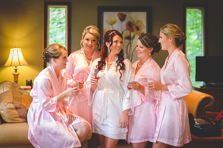 Bridesmaids robes and wedding toast photo