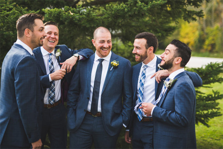 Groomsmen laughing outside photo